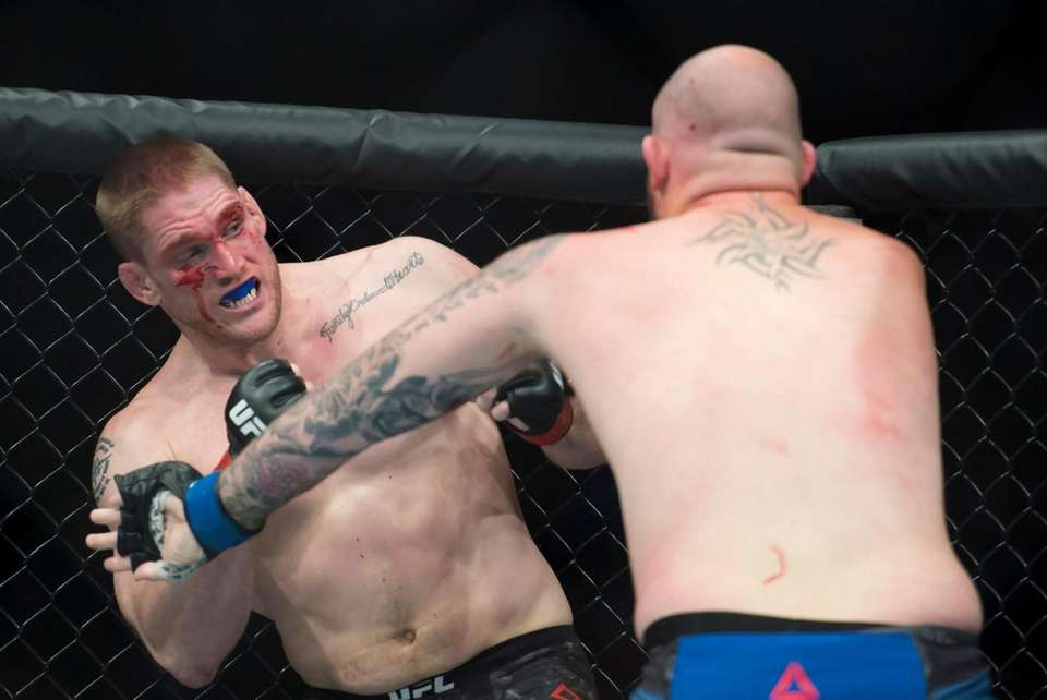 Heavyweight fighters Todd Duffee, left, fights Jeff Hughes