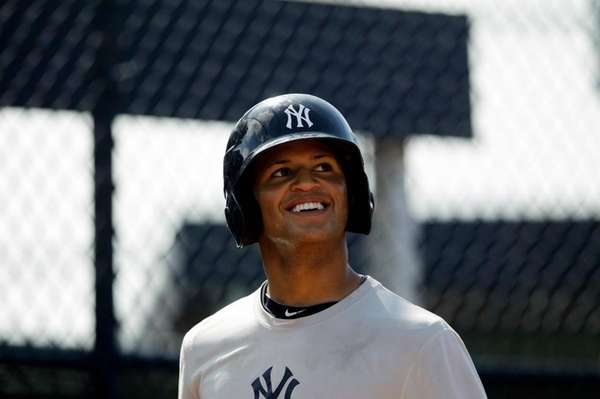 Yankees' prospect Mason Williams practices before the official