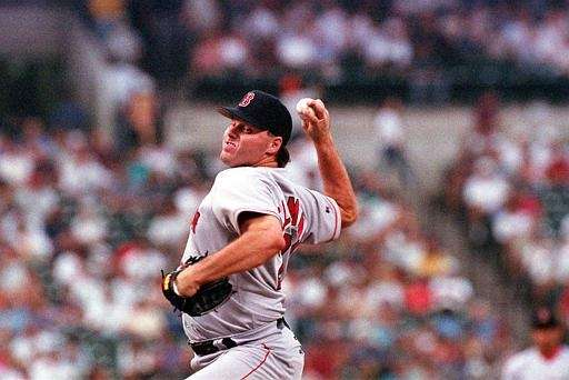 Boston Red Sox starting pitcher Roger Clemens delivers