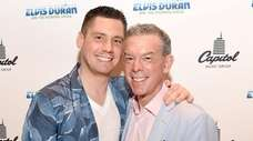 Z100's Elvis Duran, right, and partner Alex Carr