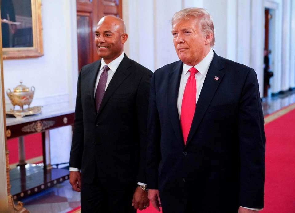 US President Donald Trump arrives with Mariano Rivera(L)