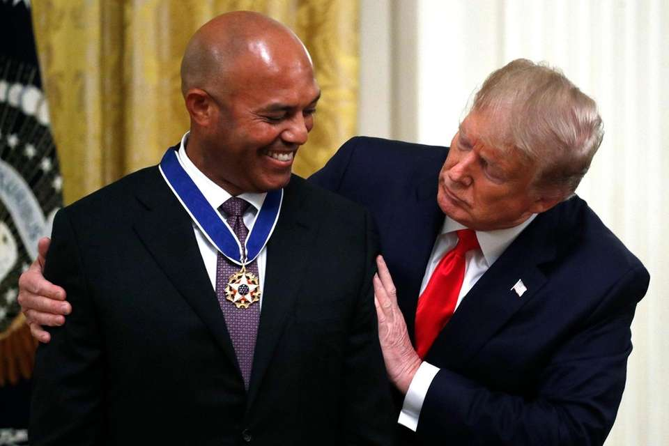 President Donald Trump presents the Presidential Medal of