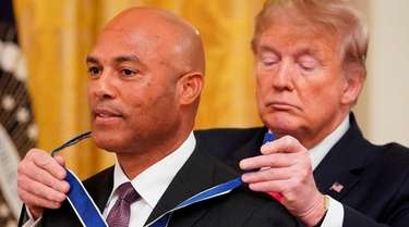 US President Donald Trump presents the Medal of