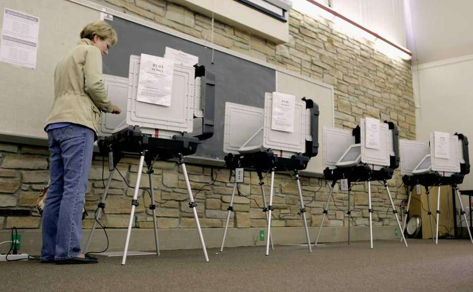 A voter uses a digital voting machine during