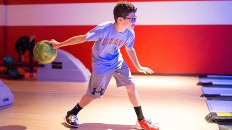 Seth Popkin of Plainview, 13, bowls at Bowlmor