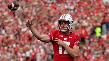 Wisconsin quarterback Jack Coan, from Sayville, shown here