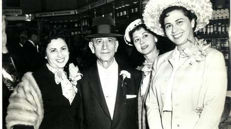 Joel Russ with his daughters, from left, Anne,