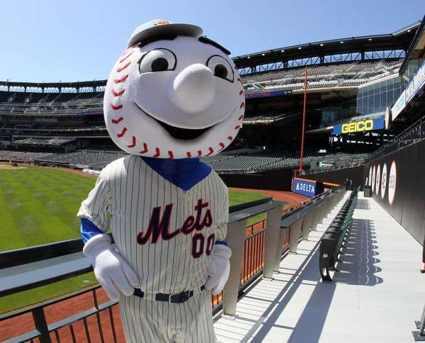 Mr. Met poses for a photograph in the