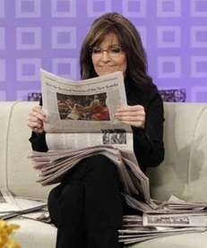 Sarah Palin reading newspapers as she co-hosts the