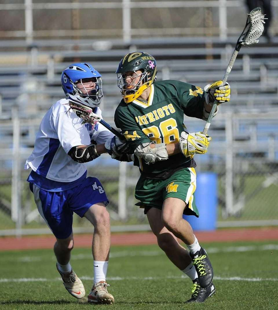 Ward Melville's Frank Lucatuorto is defended by North