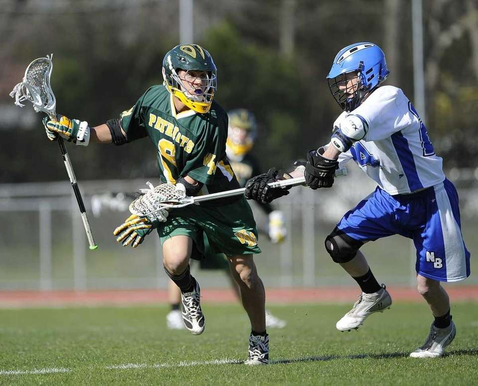 Ward Melville's Christian Mazzone is checked by North