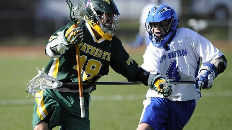 Ward Melville's Mike Rastivo is defended by North