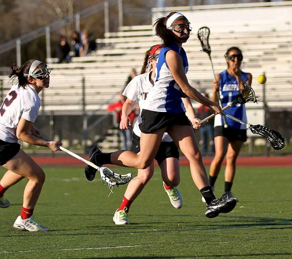 Hauppauge's Jessica Volpe #25 fires a shot on