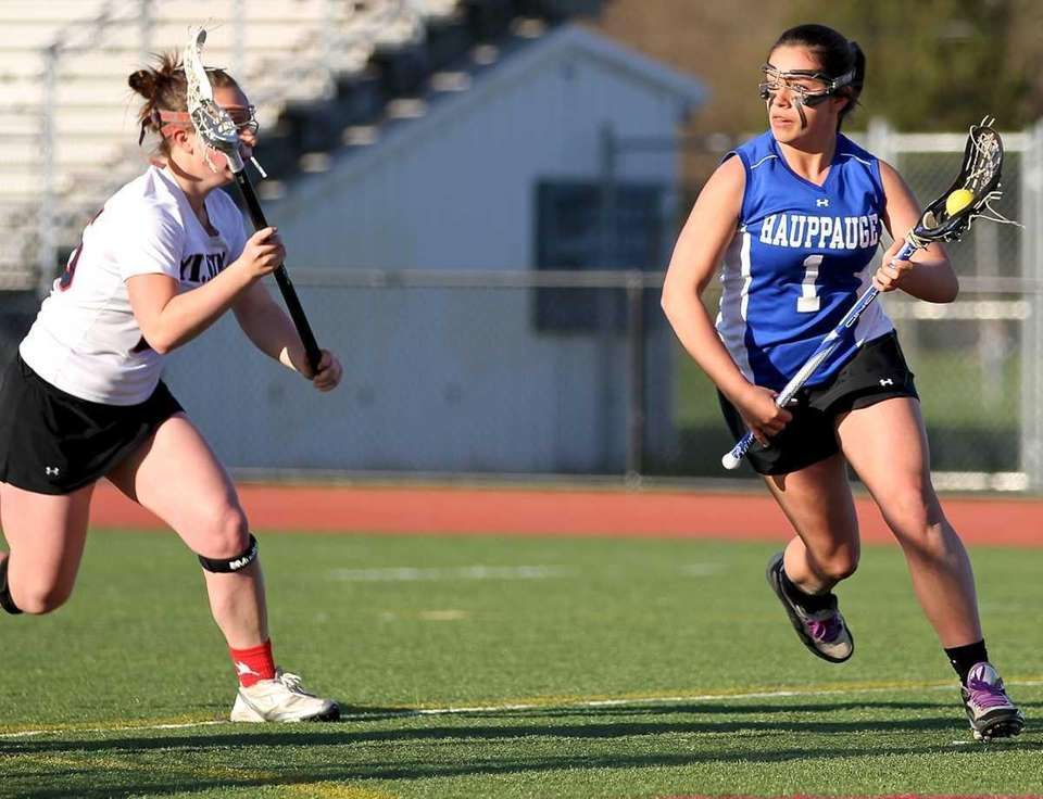 Hauppauge's Taylor Ranftle #1 moves behind the net