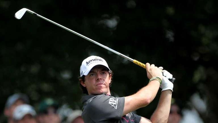 Rory McIlroy of Northern Ireland hits a tee