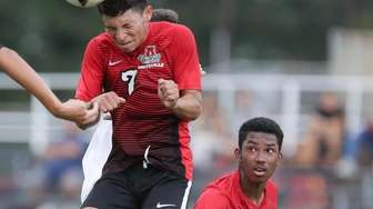 Amityville's Jeffery Saravia (7) plays the ball in
