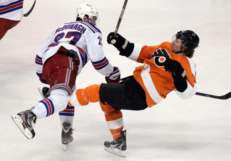 Rangers' Ryan McDonagh, left, sends Philadelphia Flyers' Scott