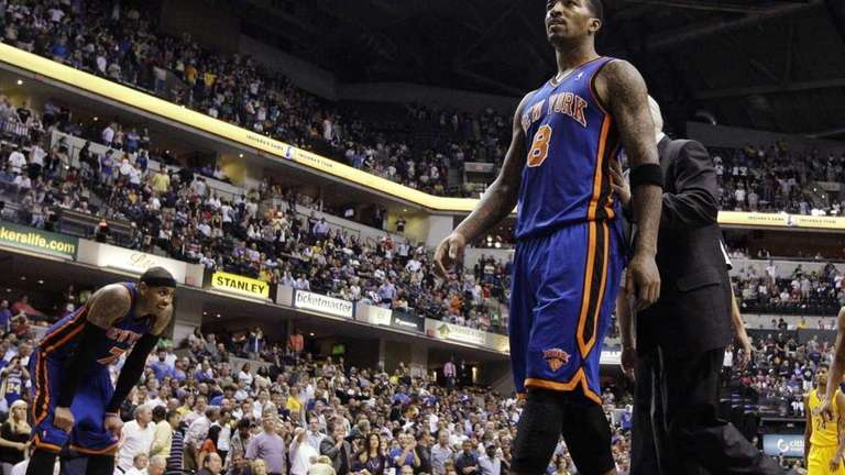 Knicks guard J.R. Smith is led off the