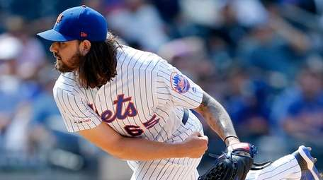 Mets starter Robert Gsellman delivers against the Nationals