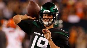 Trevor Siemian of the Jets warms up before
