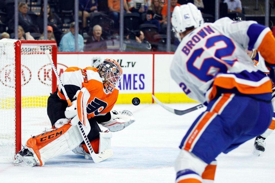 The Flyers' Brian Elliott, left, blocks a shot