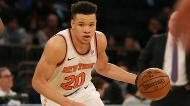 Knicks small forward Kevin Knox controls the ball