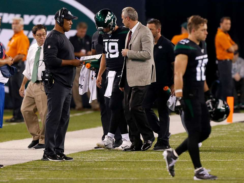 Trevor Siemian of the Jets is helped off
