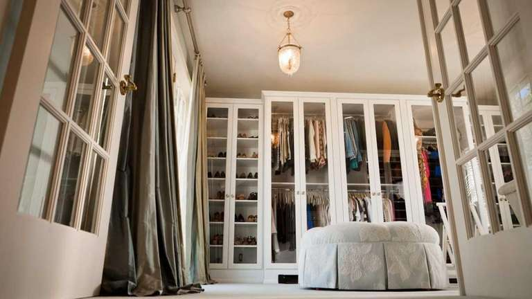 This walk-in closet in a Lloyd Harbor home