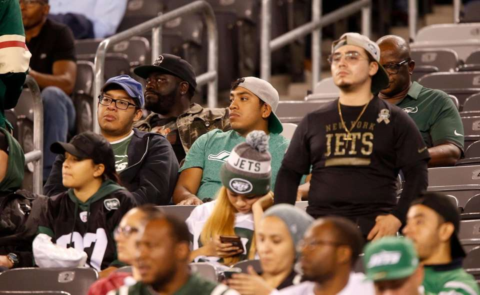 Fans looks on in the fourth quarter of