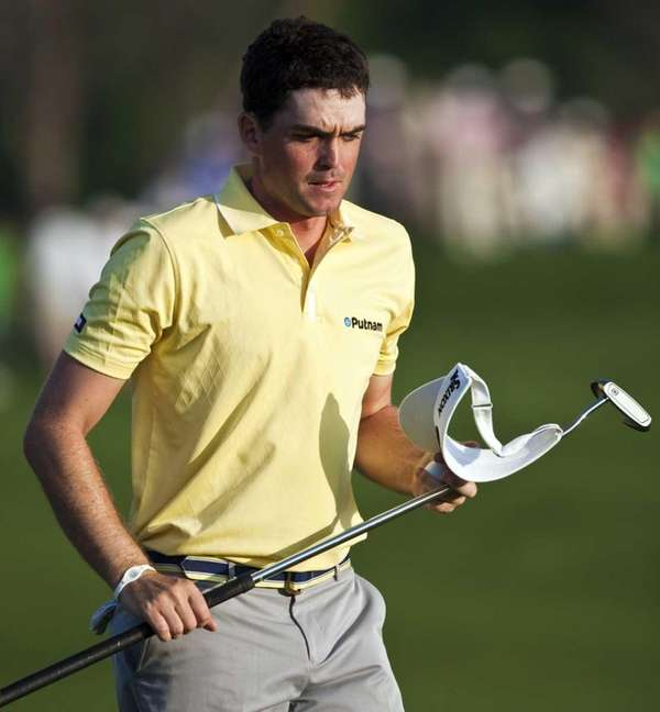 Keegan Bradley walks off the green on the