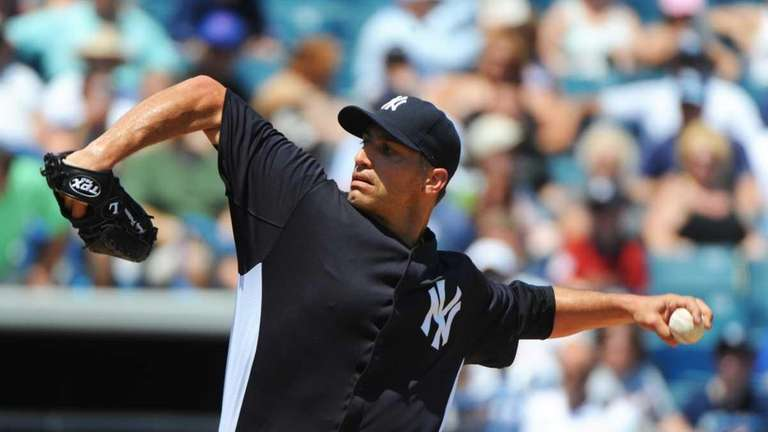 Yankees' Andy Pettitte throws against the Mets in
