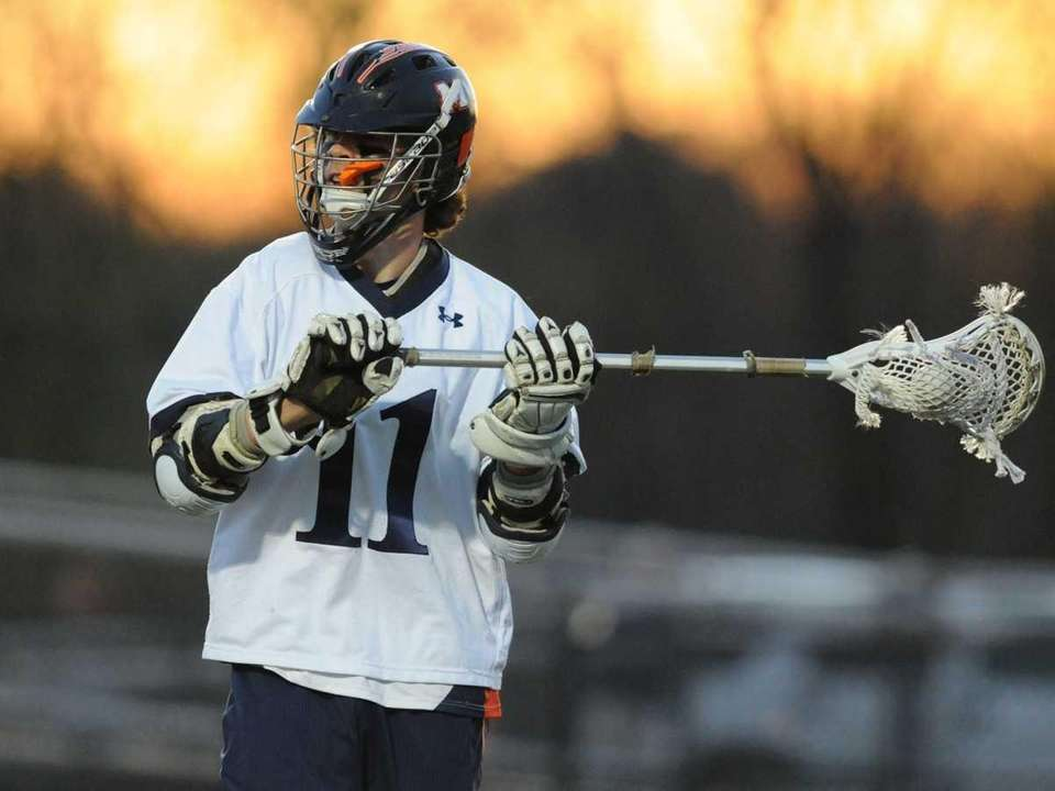 Manhasset attack #11 Quinn Moroney looks to pass