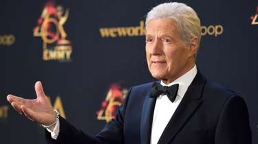 Alex Trebek poses in the press room at