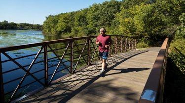 Under a blue sky, a runner passes through