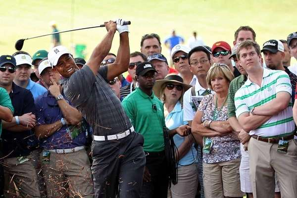 Tiger Woods hits his second shot off of