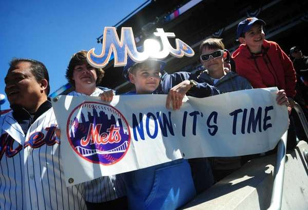Mets fan Emmet Chapey, 13, from Babylon (center)