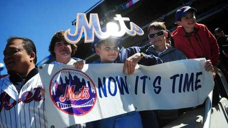 Mets fan Emmet Chapey, 13, from Babylon (center)