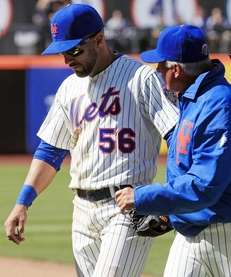 New York Mets manager Terry Collins, right, talks