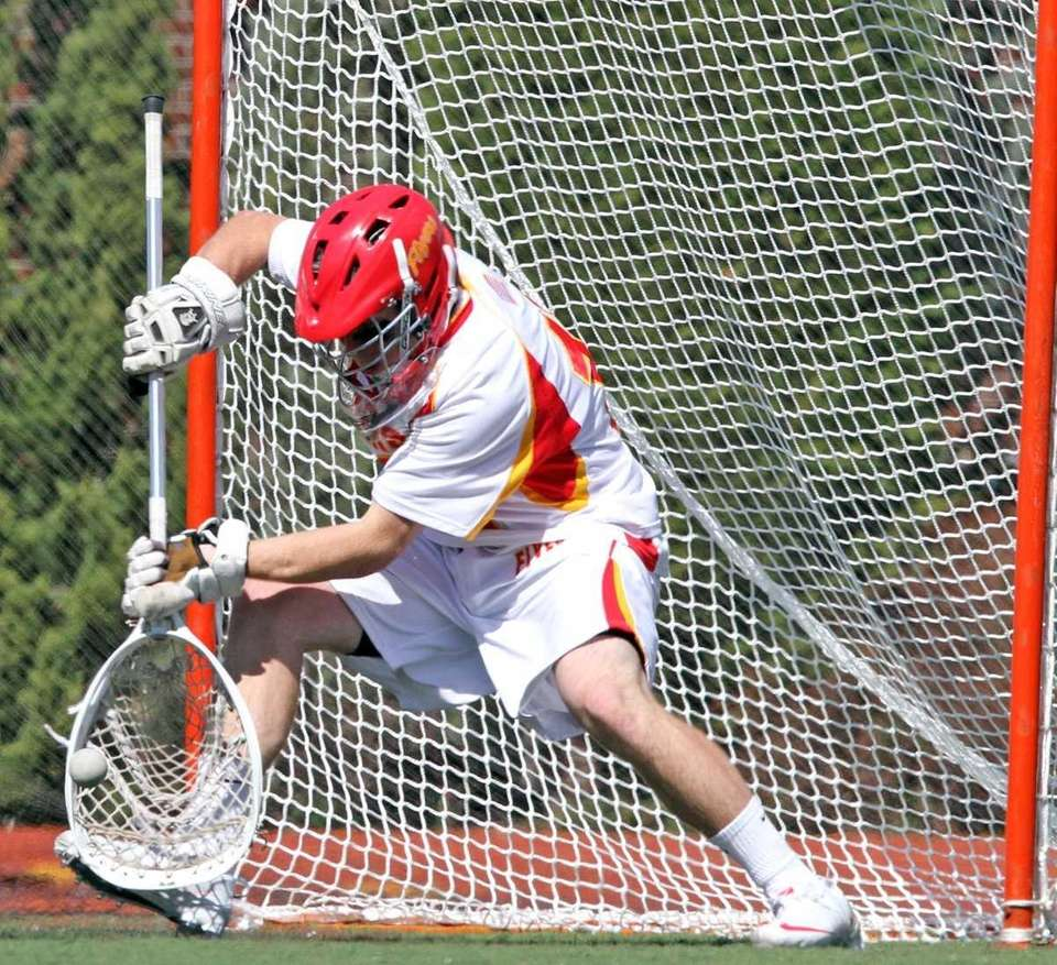 Chaminade's goalie Daniel Fowler gets the save. (April