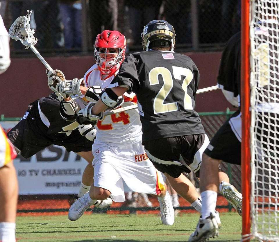 Chaminade's Ryan Lukacovic gets close to the net.