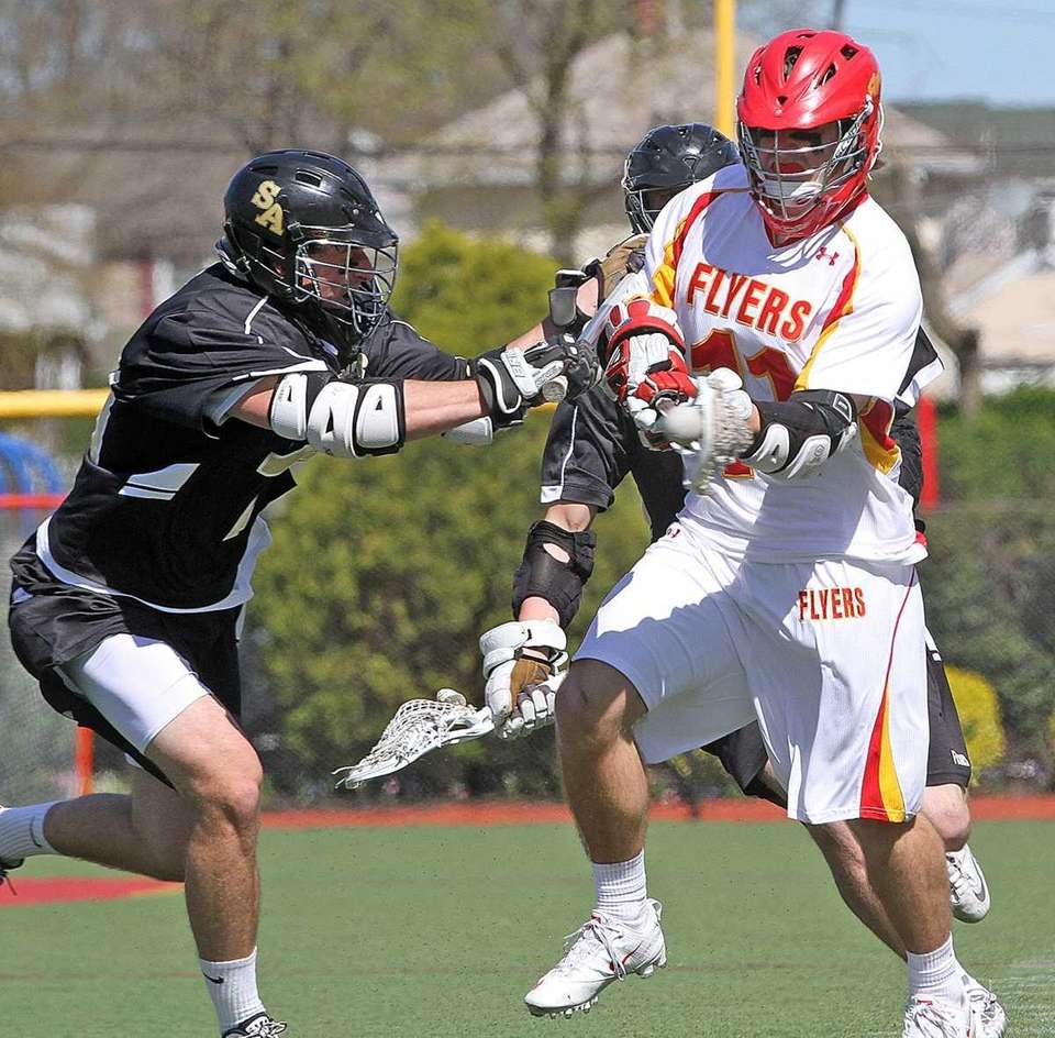 Chaminade's Paul Urbank takes a hit from St.