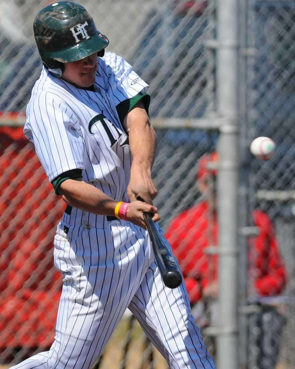 Holy Trinity left fielder #31 Peter Scacco hits