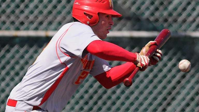 Chaminade shortstop #23 Terence Connelly bunts for a