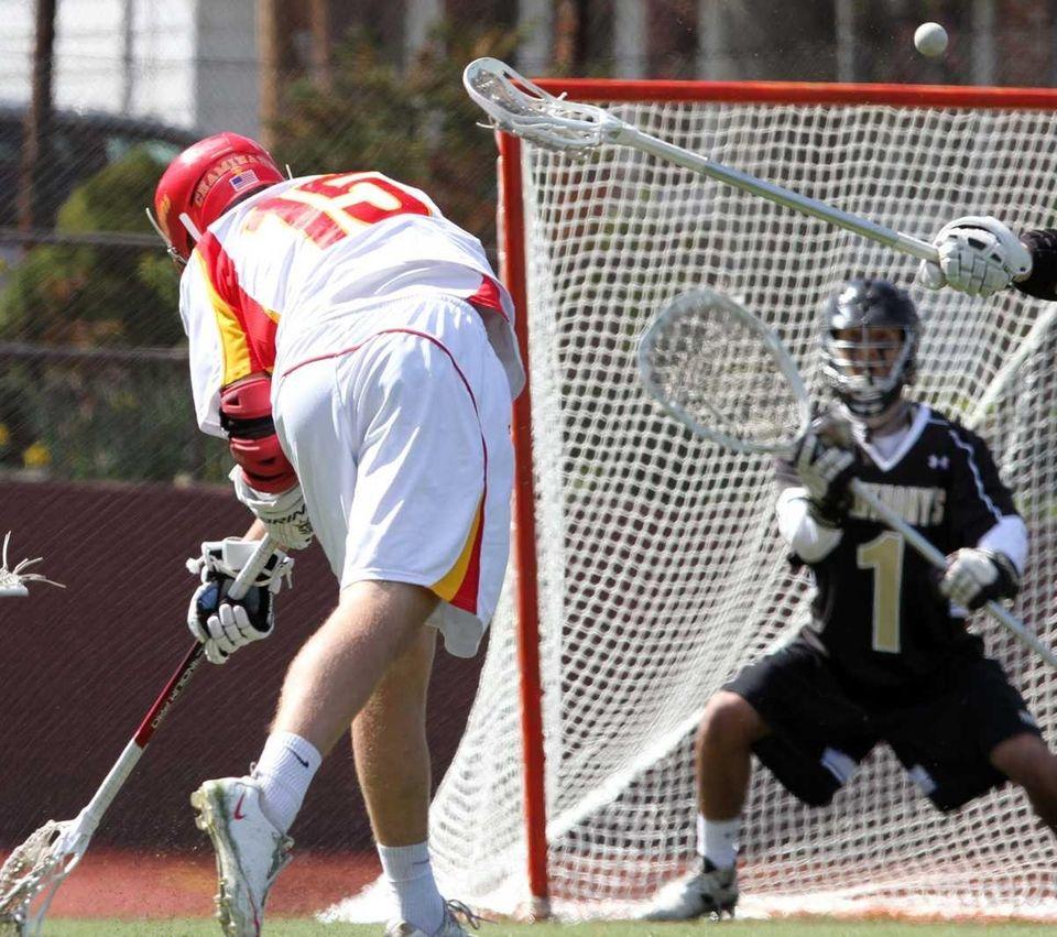Chaminade's Brendan Caputo gets the ball past St.