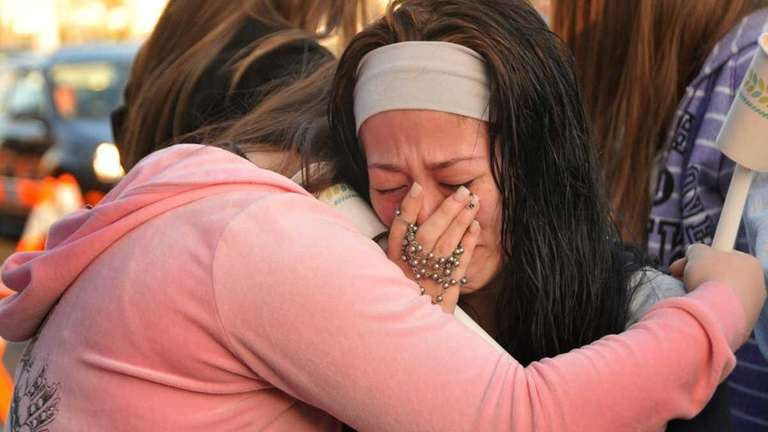 Jackie Barsotti, 16, of Levittown, is overcome by