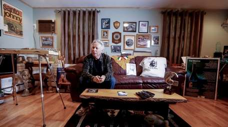 Surrounded by memorabilia, Johnny Farina, performer and co-writer