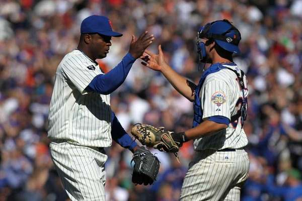 Frank Francisco celebrates with catcher Josh Thole after