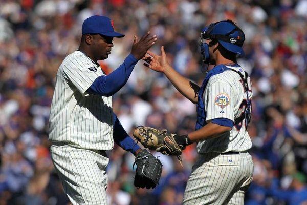 Frank Francisco celebrates with catcher Josh Thole after