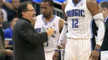 Orlando Magic coach Stan Van Gundy, left, talks