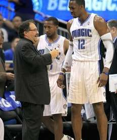 Orlando Magic coach Stan Van Gundy, left, talks